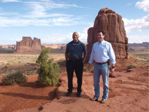 Rudy Herndon | Courtesy   Reps. Jason Chaffetz, R-Utah, and Elijah Cummings, D-Md., take a tour of some of Utah's Arches National Park.