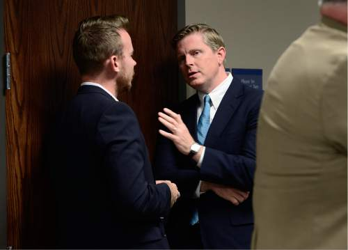 Scott Sommerdorf   |  The Salt Lake Tribune   Utah gubernatorial candidate Jonathan Johnson, right, speaks with a party member as the Utah Republican Party Central Committee met in executive session, Saturday, June 4, 2016.