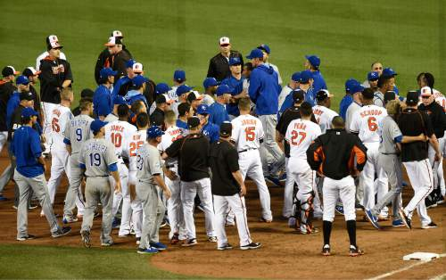 Baltimore Orioles and Kansas City Royals benches clear after Kansas City Royals pitcher Yordano Ventura threw a pitch at Baltimore Orioles Manny Machado in the fifth inning of a baseball game, Tuesday, June 7, 2016, in Baltimore. (AP Photo/Gail Burton)