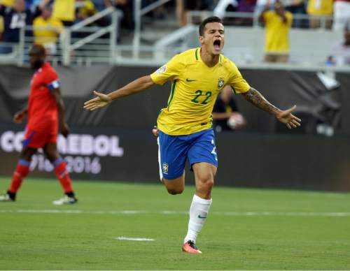 Brazil's Philippe Coutinho (22) celebrates after scoring a goal against Haiti during the first half of a Copa America group B soccer match Wednesday, June 8, 2016, in Orlando, Fla. (AP Photo/John Raoux)