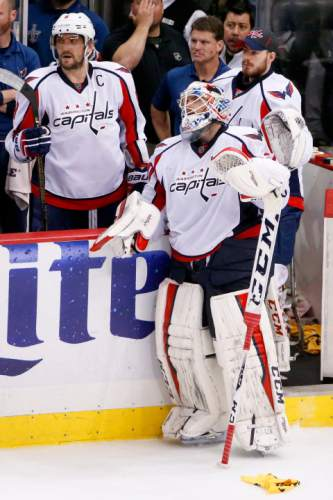 Washington Capitals goalie Braden Holtby (70) looks up towards the  scoreboard standing near Alex 3616c6e7bf21