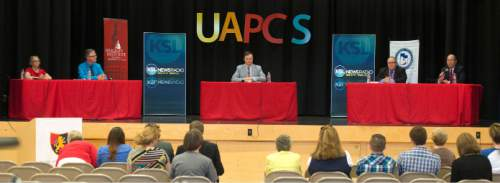 Steve Griffin / The Salt Lake Tribune  District 4 State School Board candidates Elizabeth Carlin and Brent Strate, left, and Brad Asay and Dave Thomas, right, participate in a debate sponsored by the Hinkley Institute, Sutherland Institute, and the Utah Association of Public Charter Schools at the North Davis Preparatory Academy in Layton Wednesday June 8, 2016.