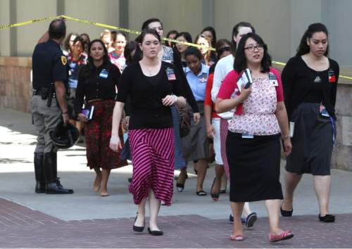 Rick Egan  | The Salt Lake Tribune   Sister missionaries are evacuated from Temple Square to be checked out by emergency personal, after a gas leak was detected in the South Visitors Center at Temple Square, Thursday, August 22, 2013.