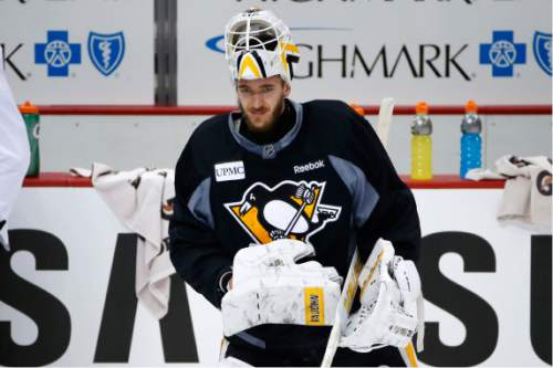 Pittsburgh Penguins goalie Matt Murray takes a break during hockey practice at the Consol Energy Center in Pittsburgh, Sunday May 29, 2016. The Penguins are preparing for Game 1 of the Stanley Cup Finals against the San Jose Sharks on Monday, May 30, in Pittsburgh. (AP Photo/Gene J. Puskar)