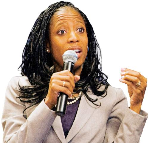 Rick Egan  |  The Salt Lake Tribune  Fourth District candidate Mia Love, answers questions separately from her opponent, Doug Owens, at the Salt Lake Chamber of Commerce, Thursday, September 25, 2014.  Love declined to participate in a joint event and asked to appear first.