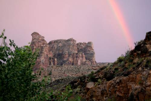 Al Hartmann  |  Tribune file photo Rainbow forms at the end of the day in Dark Canyon Wilderness in San Juan County.  The area is included for a proposed Bears Ears National Conservation Area.