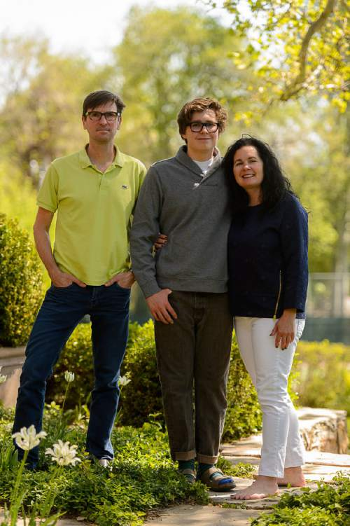 Trent Nelson     The Salt Lake Tribune Louis Fisher, center, with his parents Ethan and Kelly, in Salt Lake City, Thursday May 12, 2016. Fisher is a gay student at Judge Memorial High School. He's collected 1,000 signatures on a petition for a  gay-straight-alliance at the private Catholic High School. So far officials have said no.