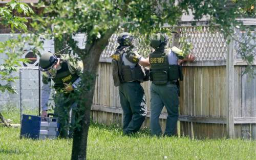 Bomb disposal officers check for bombs at an apartment complex possibly linked to the fatal shootings at an Orlando nightclub, Sunday, June 12, 2016, in Fort Pierce, Fla. (AP Photo/Alan Diaz)