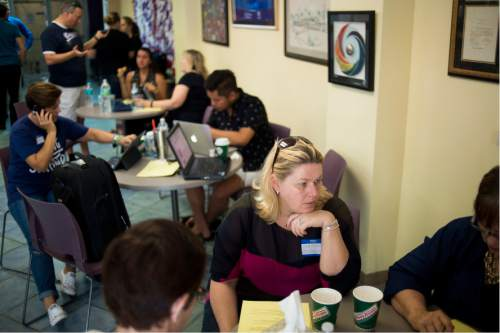 Volunteers provide counseling at The LGBTQ Community Center after the late night shooting at Pulse, an Orlando night club, on Sunday, June 12, 2016 in Orlando. A gunman wielding an assault-type rifle and a handgun opened fire inside a crowded Florida nightclub before dying in a gunfight with SWAT officers, police say. The attack left at least 50 people dead, making it the worst mass shooting in American history. (Zack Wittman/Tampa Bay Times via AP)
