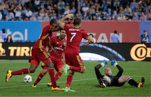 Real Salt Lake players celebrate after forward Juan Martinez (7) scored a goal against New York City FC goalkeeper Josh Saunders, right, during the second half of an MLS soccer game, Thursday, June 2, 2016, in New York. Real Salt Lake won 3-2. (AP Photo/Julie Jacobson)