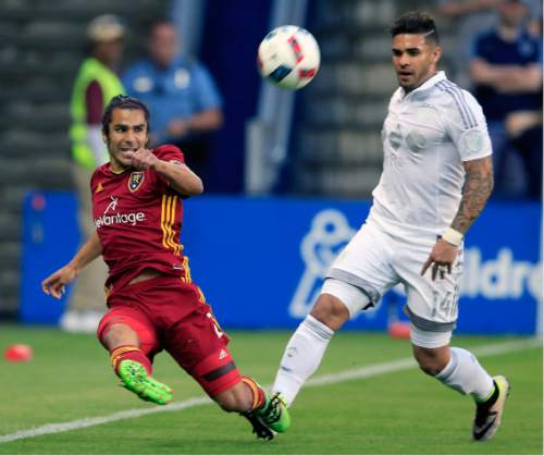 Real Salt Lake defender Tony Beltran (2) clears the ball away from Sporting Kansas City forward Dom Dwyer (14) during the first half of an MLS soccer match in Kansas City, Kan., Saturday, May 21, 2016. (AP Photo/Orlin Wagner)