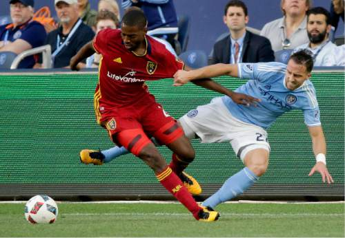 Real Salt Lake defender Aaron Maund, left, vies for the ball against New York City FC defender RJ Allen during the first half of an MLS soccer game, Thursday, June 2, 2016, in New York. Real Salt Lake won 3-2. (AP Photo/Julie Jacobson)
