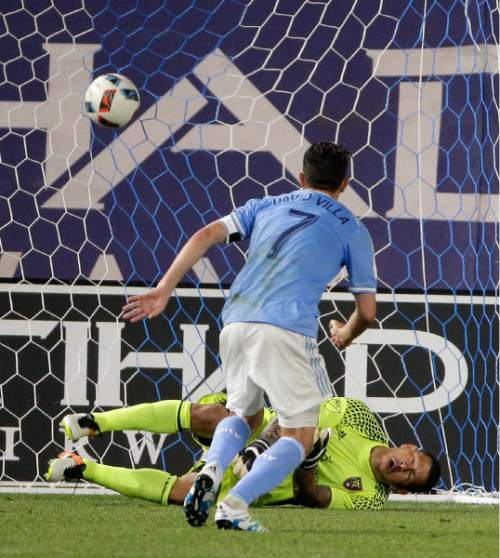 New York City FC forward David Villa (7) scores a goal on a penalty kick against Real Salt Lake goalkeeper Nick Rimando (18) during the second half of an MLS soccer game, Thursday, June 2, 2016, in New York. Real Salt Lake won 3-2. (AP Photo/Julie Jacobson)