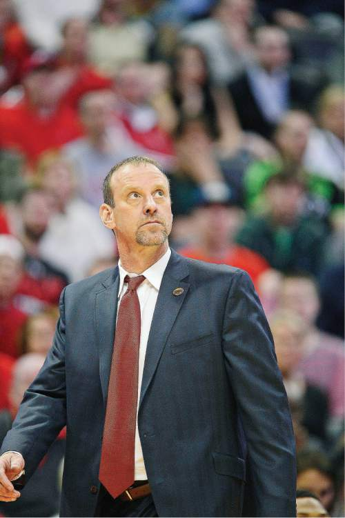 Scott Sommerdorf   |  The Salt Lake Tribune   Utah Utes head coach Larry Krystkowiak glances at the scoreboard late in the second half after Utah took back the momentum and the lead. Utah beat Fresno State 80-69 in Denver, Thursday, March 17, 2016.