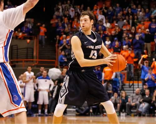 Utah State's David Collette (13) looks for a pass during the second half of an NCAA college basketball game against Boise State in Boise, Idaho, on Saturday, Jan. 3, 2015. Utah State won 62-61. (AP Photo/Otto Kitsinger)