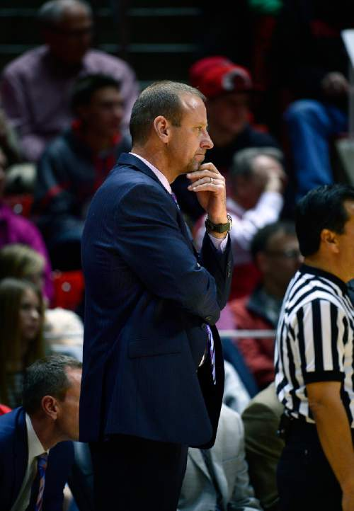 Scott Sommerdorf   |  The Salt Lake Tribune Utah Utes head coach Larry Krystkowiak considers the play as the Utes are on offense during second half play. Utah beat North Dakota 90-53 in the Utah Thanksgiving Tournament, Friday, November 28, 2014.