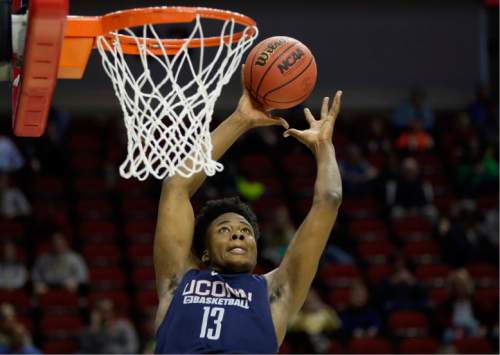 FILE - In this March 16, 2016, file photo, Connecticut forward Steven Enoch dunks the ball during practice ahead of a first round men's college basketball game in the NCAA Tournament, in Des Moines, Iowa. UConn center Steven Enoch has never been to Armenia, or anywhere overseas for that matter. But next month, the 6-foot-11 sophomore from Norwalk will be travelling to Greece to play for the U-20 Armenian national team at the Division B European Championships. (AP Photo/Charlie Neibergall, File)