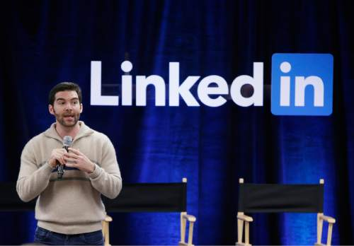 """FILE - In this Nov. 6, 2014, file photo, LinkedIn CEO Jeff Weiner speaks during the company's second annual """"Bring In Your Parents Day,"""" at LinkedIn headquarters in Mountain View, Calif. Microsoft said Monday, June 13, 2016, it is buying professional networking service site LinkedIn for about $26.2 billion. LinkedIn, based in Mountain View, Calif., has more than 430 million members. (AP Photo/Marcio Jose Sanchez, File)"""