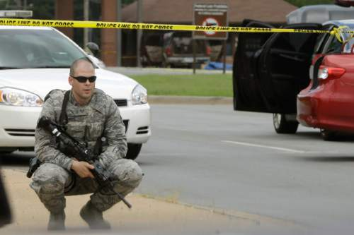Danny Johnston  |  AP file photo A member of an Air Force security detail guards the front gate of little Rock Air Force Base near Jacksonville, Ark., last year after a shooting by an intruder.