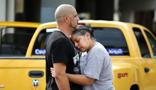 Joe Burbank  |  AP file photo Ray Rivera, left, a DJ at Pulse Orlando nightclub, is consoled by a friend, outside of the Orlando Police Department after a shooting involving multiple fatalities at the nightclub, Sunday, June 12, 2016, in Orlando, Fla.
