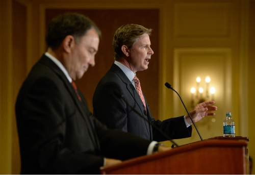 Francisco Kjolseth | Tribune file photo This file photo from April shows Republican Gov. Gary Herbert, left, and challenger Jonathan Johnson together for their first full debate. A new Tribune-Hinckley Institute poll shows Herbert with a commanding lead.