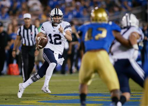 BYU quarterback Tanner Mangum scrambles against UCLA during the first half of an NCAA college football game Saturday, Sept. 19, 2015, in Pasadena, Calif. (AP Photo/Danny Moloshok)