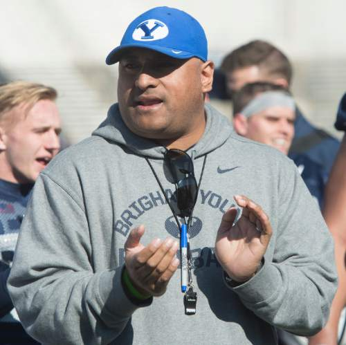Rick Egan  |  The Salt Lake Tribune  BYU head football coach Kalani Sitake  sings the Cougar fight song, after BYU's final practice of spring camp, at LaVell Edwards Stadium, Friday, April 1, 2016.