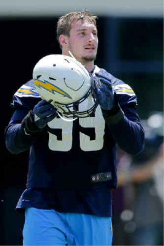 San Diego Chargers rookie defensive end Joey Bosa takes off his helmet during an NFL football rookie training camp Friday, May 13, 2016, in San Diego. (AP Photo/Gregory Bull)
