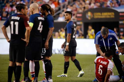 United States' DeAndre Yedlin (2) walks off the field after receiving his second yellow card during the second half of a Copa America Group A soccer match against Paraguay, Saturday, June 11, 2016, in Philadelphia. United States won 1-0. (AP Photo/Matt Rourke)