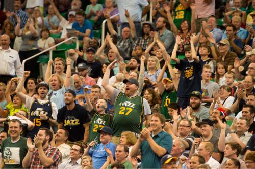 Rick Egan  |  The Salt Lake Tribune  Utah Jazz fans cheer as Utah Jazz guard Bryce Cotton hit a shot at the buzzer at the end of the half, in Utah Jazz Summer League action, Utah Jazz vs. The Boston Celtics, at EnergySolutions Arena, Monday, July 6, 2015.