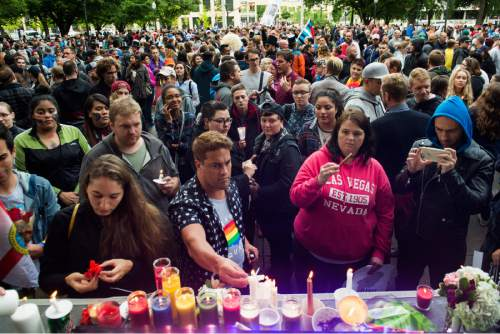Rick Egan     The Salt Lake Tribune  Candles are oft at the ergo of the stage, after the candlelight vigil in the wake of the mass shooting in Orlando, at the City & County Building, Monday, June 13, 2016.