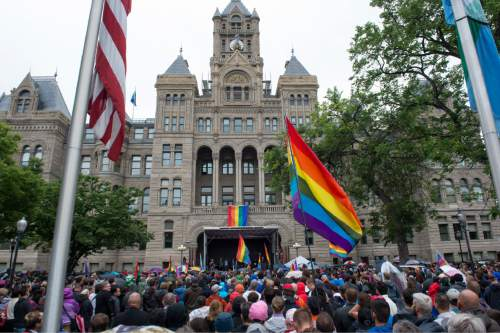 Rick Egan     The Salt Lake Tribune Crowds gather for a candlelight vigil in the wake of the mass shooting in Orlando, at the City & County Building on Monday.