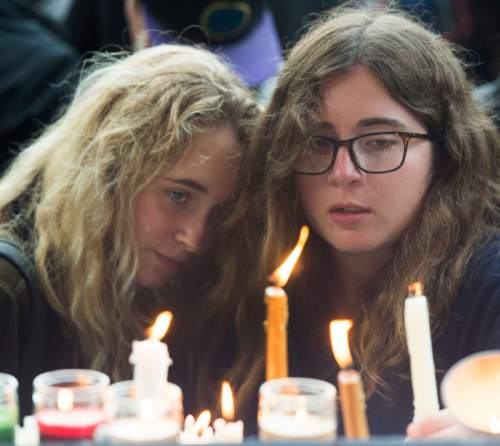 Rick Egan     The Salt Lake Tribune  Miabella Brickey and Quincy Pinnell-Jackson place their candles on the edge of the stage, at the candlelight vigil in the wake of the mass shooting in Orlando, at the City & County Building, Monday, June 13, 2016.