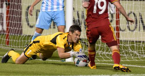 Leah Hogsten  |  The Salt Lake Tribune Wilmington's goalie John Smits pounces on the ball before Real Salt Lake midfielder Luke Mulholland (19) can get his foot on it. Real Salt Lake defeated Wilmington Hammerheads FC 2-2 and 3-1in the shoot out during their fourth round 2016 U.S. Open Cup match at Rio Tinto Stadium, Tuesday, June 14, 2016 in Sandy.