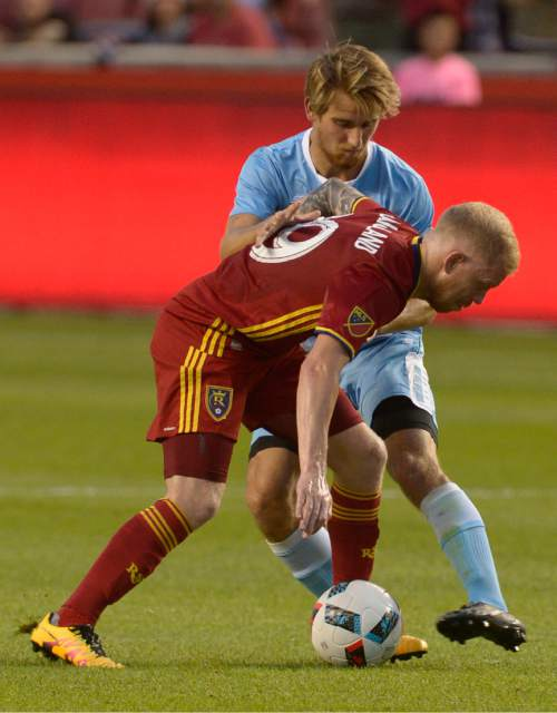 Leah Hogsten  |  The Salt Lake Tribune Real Salt Lake midfielder Luke Mulholland (19) and Wilmington's Kyle Parker fight for possession. Real Salt Lake is a goal behind Wilmington Hammerheads FC 0-1 at the half during their fourth round 2016 U.S. Open Cup match at Rio Tinto Stadium, Tuesday, June 14, 2016 in Sandy.