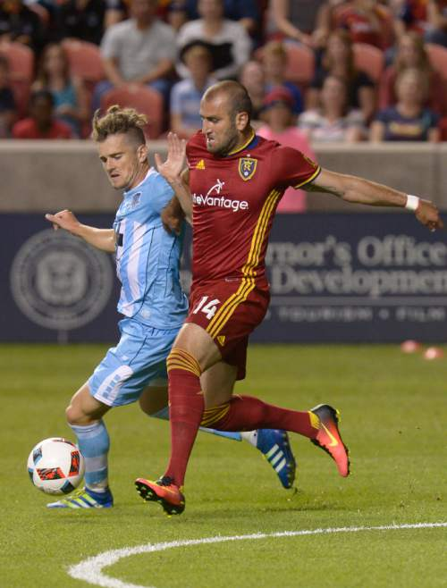 Leah Hogsten  |  The Salt Lake Tribune Real Salt Lake forward Yura Movsisyan (14) and Wilmington's Mael Corboz fight for possession. Real Salt Lake defeated Wilmington Hammerheads FC 2-2 and 3-1in the shoot out during their fourth round 2016 U.S. Open Cup match at Rio Tinto Stadium, Tuesday, June 14, 2016 in Sandy.