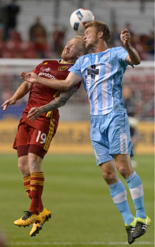 Leah Hogsten  |  The Salt Lake Tribune Real Salt Lake midfielder Luke Mulholland (19) and Wilmington's Michael Mecham go up for a header. Real Salt Lake defeated Wilmington Hammerheads FC 2-2 and 3-1in the shoot out during their fourth round 2016 U.S. Open Cup match at Rio Tinto Stadium, Tuesday, June 14, 2016 in Sandy.