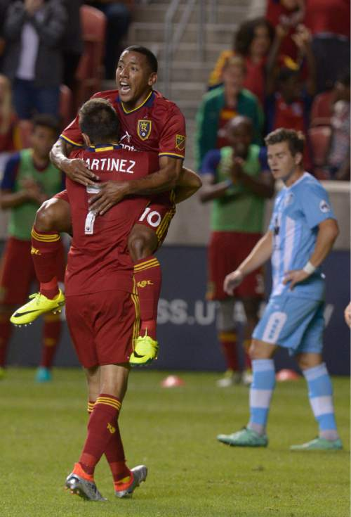 Leah Hogsten  |  The Salt Lake Tribune Real Salt Lake forward Juan Martinez (7) celebrates his second half goal with Real Salt Lake forward Joao Plata (10). Real Salt Lake defeated Wilmington Hammerheads FC 2-2 and 3-1in the shoot out during their fourth round 2016 U.S. Open Cup match at Rio Tinto Stadium, Tuesday, June 14, 2016 in Sandy.