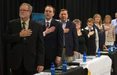 Steve Griffin  |  The Salt Lake Tribune Candidate for the District 7 seat of the state school board say the Pledge of Allegiance before a debate hosted by Hinckley Institute of Politics, the Sutherland Institute, KSL and the Utah Association of Public Charter Schools at the Salt Lake Arts Academy in Salt Lake City on Wednesday, June 15, 2016.