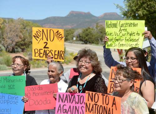 Al Hartmann  |  The Salt Lake Tribune A couple dozen Native Americans, many from the Navajo tribe hold signs protesting the proposed Bears Ears National Monument at a meeting with Utah Senator Orrin Hatch and Gov. Gary Herbert held at Natural Bridges National Monument Thursday June 2.   The Bears Ears formation is behind them.