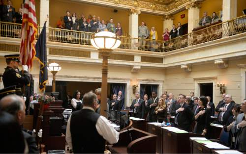 Al Hartmann  |  The Salt Lake Tribune Members of the Utah Senate stand as Garfield County Commissioner Dell LeFevre, lower left, leads the body in the Pledge of Allegiance to open the 2016 session of the Utah Legislature Monday Jan. 25.