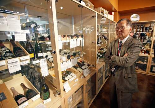 State Sen. Brian E. Shiozawa, R-Salt Lake City, looks on during a tour of a state liquor store ,Thursday, June 16, 2016, in Salt Lake City. Utah lawmakers toured a state liquor store and warehouse as critics say Utah's alcohol control agency needs more money and stores to meet the demand from residents.(AP Photo/Rick Bowmer)
