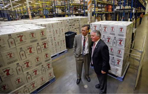 State Sen. Brian E. Shiozawa, left, R-Salt Lake City, and Rep. Dixon Pitcher, R-Ogden, pose for a photograph during a tour of the Department of Alcoholic Beverage Control warehouse Thursday, June 16, 2016, in Salt Lake City. Utah lawmakers toured a state liquor store and warehouse as critics say Utah's alcohol control agency needs more money and stores to meet the demand from residents. (AP Photo/Rick Bowmer)