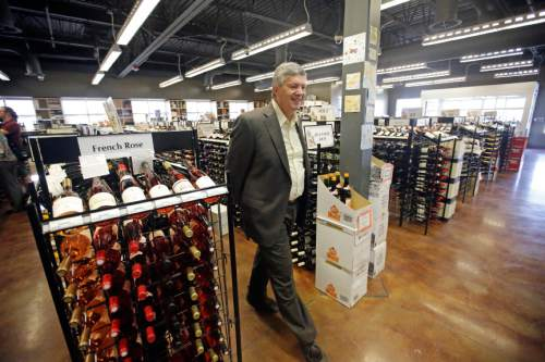 State Sen. Wayne Harper, R- Taylorsville, looks on during a tour of a state liquor store Thursday, June 16, 2016, in Salt Lake City. Utah lawmakers toured a state liquor store and warehouse as critics say Utah's alcohol control agency needs more money and stores to meet the demand from residents. (AP Photo/Rick Bowmer)