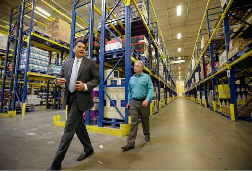 Salvador D. Petilos, left, with the Department of Alcoholic Beverage Control, walks with State Sen. Gene Davis, D-Salt Lake, during a tour of the Department of Alcoholic Beverage Control warehouse Thursday, June 16, 2016, in Salt Lake City. Utah lawmakers tour ed a state liquor store and warehouse as critics say Utah's alcohol control agency needs more money and stores to meet the demand from residents. (AP Photo/Rick Bowmer)