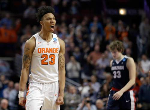 Syracuse's Malachi Richardson (23) reacts in the closing seconds of a college basketball game against Gonzaga in the regional semifinals of the NCAA Tournament, Friday, March 25, 2016, in Chicago. Syracuse won 63-60. (AP Photo/Nam Y. Huh)