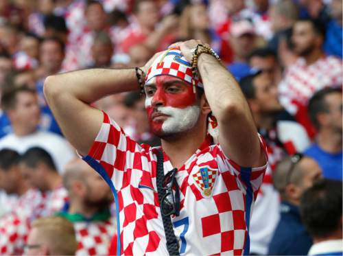 A Croatia's team fan holds his head  during the Euro 2016 Group D soccer match between the Czech Republic and Croatia at the Geoffroy Guichard stadium in Saint-Etienne, France, Friday, June 17, 2016. (AP Photo/Darko Bandic)