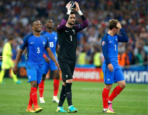 Frome left, France's Patrice Evra, goalkeeper Hugo Lloris and Antoine Griezmann celebrate their side's 2-0 win, at the end of the Euro 2016 Group A soccer match between France and Albania at the Velodrome stadium in Marseille, France, Wednesday, June 15, 2016. (AP Photo/Thibault Camus)