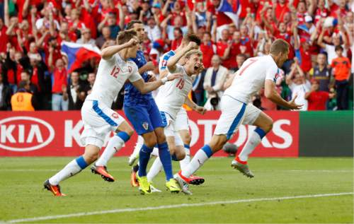 Czech Republic's Tomas Necid, right, celebrates after scoring his side's second goal during the Euro 2016 Group D soccer match between the Czech Republic and Croatia at the Geoffroy Guichard stadium in Saint-Etienne, France, Friday, June 17, 2016. (AP Photo/Laurent Cipriani)