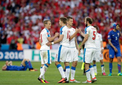 Czech Republic players celebrate at the end of the Euro 2016 Group D soccer match between the Czech Republic and Croatia at the Geoffroy Guichard stadium in Saint-Etienne, France, Friday, June 17, 2016. (AP Photo/Pavel Golovkin)